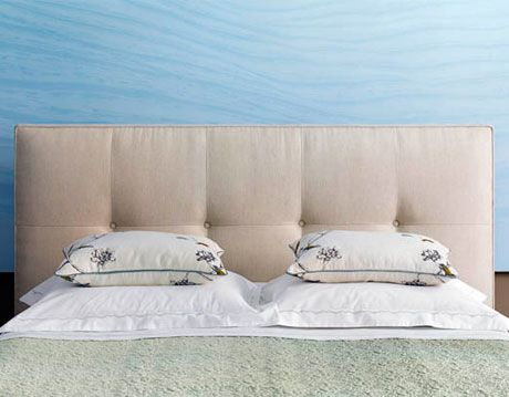 bed with pillows laid flat