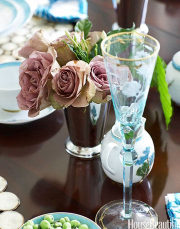 champagne flute and vase of roses
