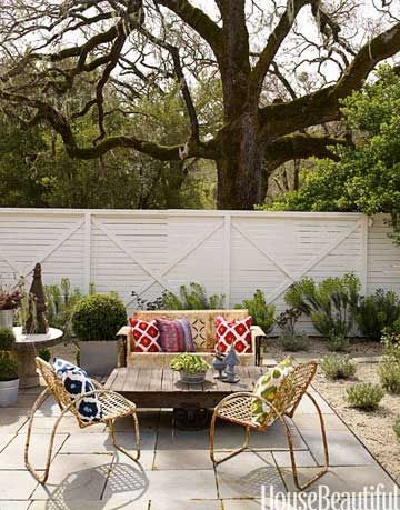 outdoor sitting area with loveseat and chairs