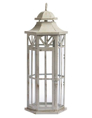 white lantern with glass panels