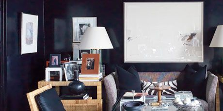 seating area with black wallpaper