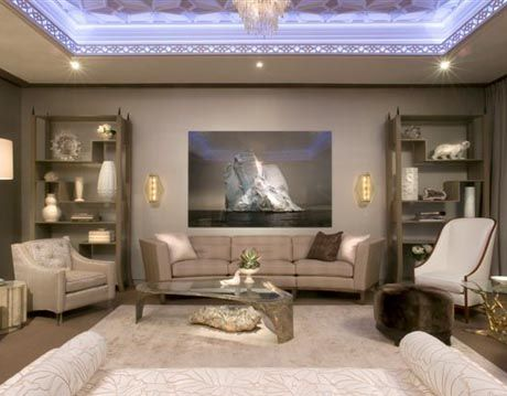 living room with vaulted ceiling and designed in neutrals