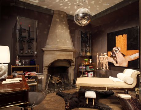 dark safe room with disco ball and mix of contemporary and antique pieces