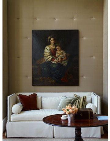 sofa with painting on wall behind