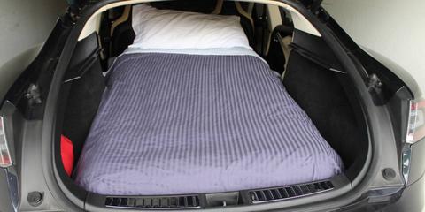 Motor vehicle, Trunk, Car seat, Car, Vehicle door, Luxury vehicle, Car seat cover, Personal luxury car, Grille, Convertible,