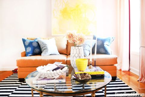 Blue, Room, Interior design, Yellow, Home, Living room, Furniture, Orange, Wall, Pillow,