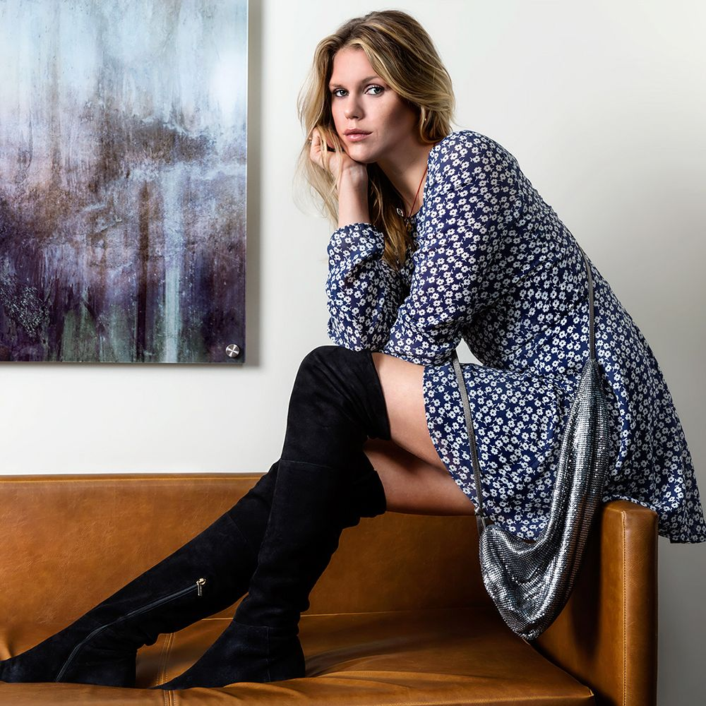"""""""I'd wear this to run around, to catch up with friends or to meetings. I find a&nbsp&#x3B;blue dress with flowers to be great for those occasions—it's fun and welcoming!""""Wearing<strong> Reformation</strong> dress, <strong>Jimmy Choo</strong> boots."""