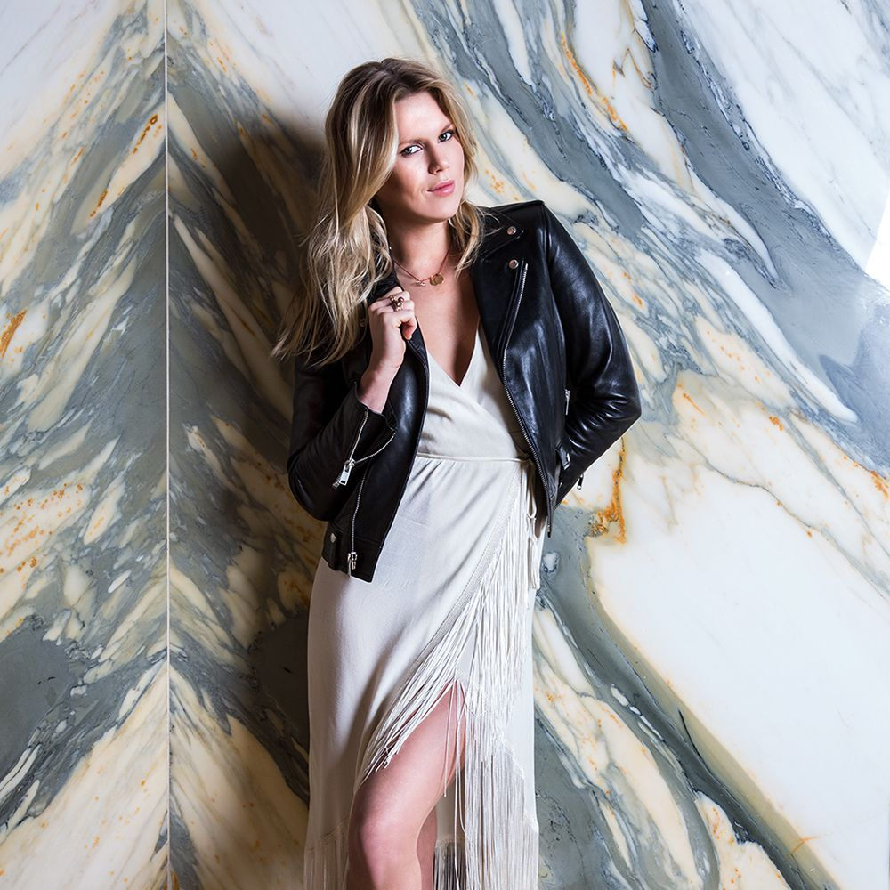 """""""The white party dress with my new Tommy Hilfiger shoes are for a night to remember. It's a fun look and great for dancing. Which, when I'm not behind the decks, I love to do.""""Wearing <strong>Reformation</strong> dress, <strong>Saint Laurent</strong> jacket"""
