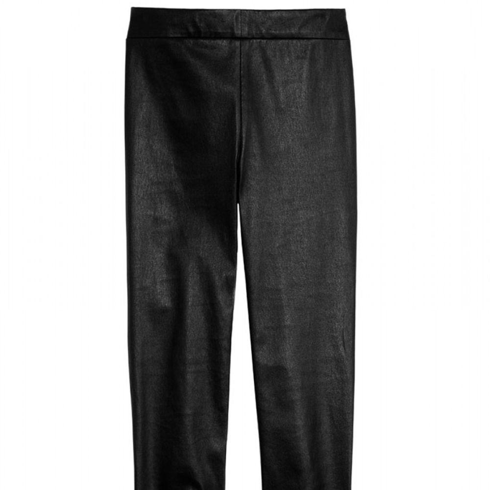 "<strong>Vince </strong>leggings, $1,250, <a href=""http://shop.harpersbazaar.com/designers/vince/ankle-zip-leather-leggings/"">shopBAZAAR.com</a>."