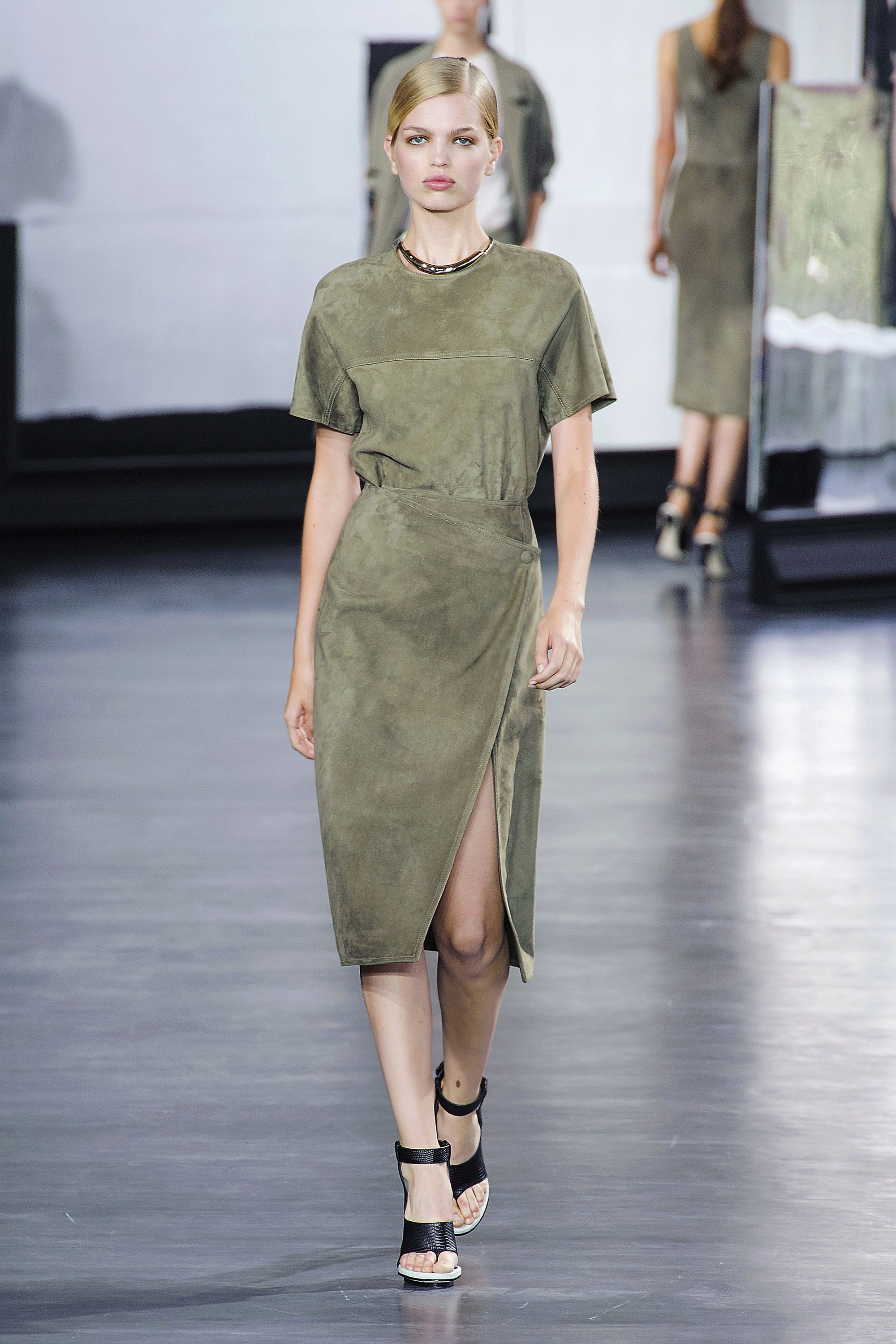 Attention! For spring, Marc Jacobs, Jason Wu (pictured left), Gucci and others are outfitting women with a modern twist on utilitarian style—with dresses in sleek satins and sumptuous suedes in shades of army green.  <em>Stylist Tip: Take this look into evening with a strappy shoe.</em>  <em>  </em>