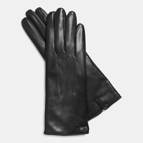 "Coach Leather Tech Glove, $74;<a href=""http://www.coach.com/online/handbags/Product-coach-10551-10051-85125-en?cs=blk&amp;storeId=10551&amp;catalogId=10051&amp;langId=-1&amp;partNumber=85125_blk&amp;Cid=A_L1&amp;siteID=Hy3bqNL2jtQ-1RlDtpfiGMIcV1cPXiHWwQ""> coach.com</a>  <!--EndFragment-->"