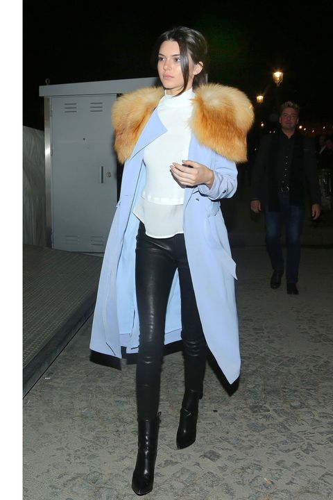 Kendall Jenner shows off her fashion style on a cold night in Paris at the Ferris Wheel with some fun and a flowing light blue jacket. The young model is in town for fashion week and enjoyed some downtime with her momager, Kris Jenner and some friends for a night on the Ferris Wheel overlooking Paris and the Eiffel tower.