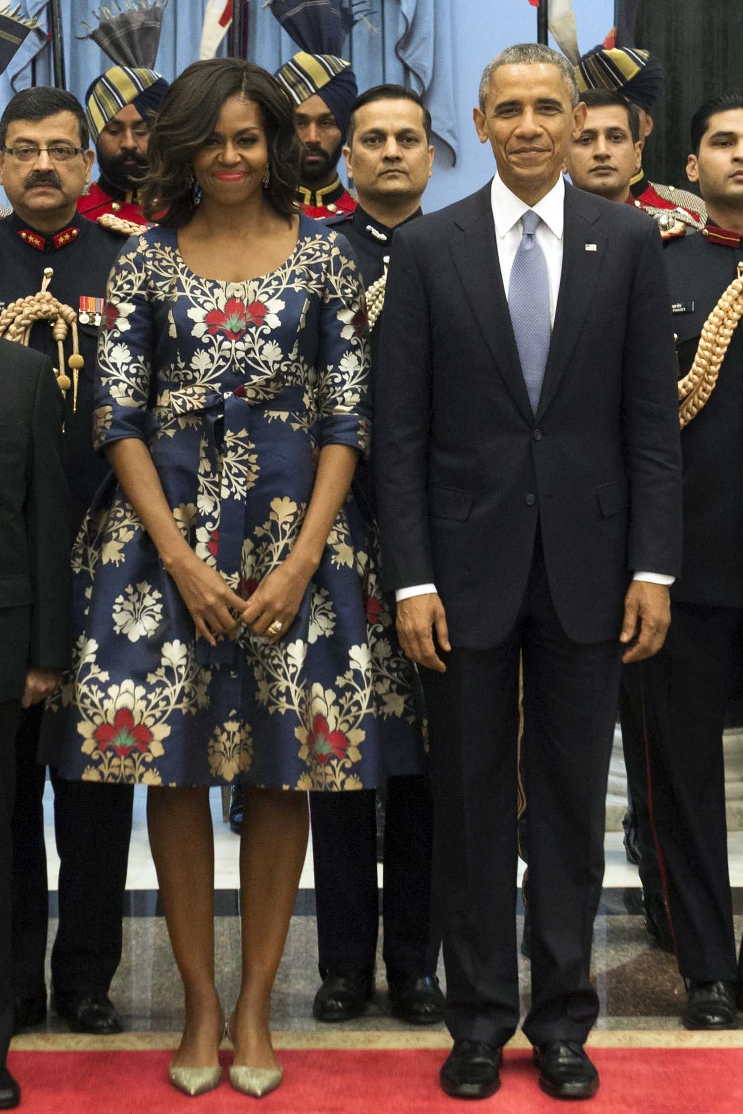 Indian President Pranab Mukherjee (L) stands alongside US President Barack Obama and First Lady Michelle Obama prior to participating in a receiving line before a State Dinner at Rashtrapati Bhawan, the Presidential Palace, in New Delhi, India, January 25, 2015. AFP PHOTO / SAUL LOEB        (Photo credit should read SAUL LOEB/AFP/Getty Images)
