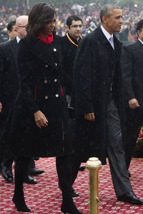Indian Prime Minister Narendra Modi (R) escorts US President Barack Obama (C) and First Lady Michelle Obama (L) as they arrive to attend India's Republic Day Parade in New Delhi on January 26, 2015. Barack Obama will become the first US president to be chief guest at India's Republic Day parade on January 26, a day after hailing a new era of friendship between the world's biggest democracies. AFP PHOTO / SAUL LOEB        (Photo credit should read SAUL LOEB/AFP/Getty Images)