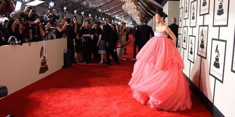 Flooring, Dress, Carpet, Premiere, Floor, Formal wear, Gown, One-piece garment, Public event, Red carpet,
