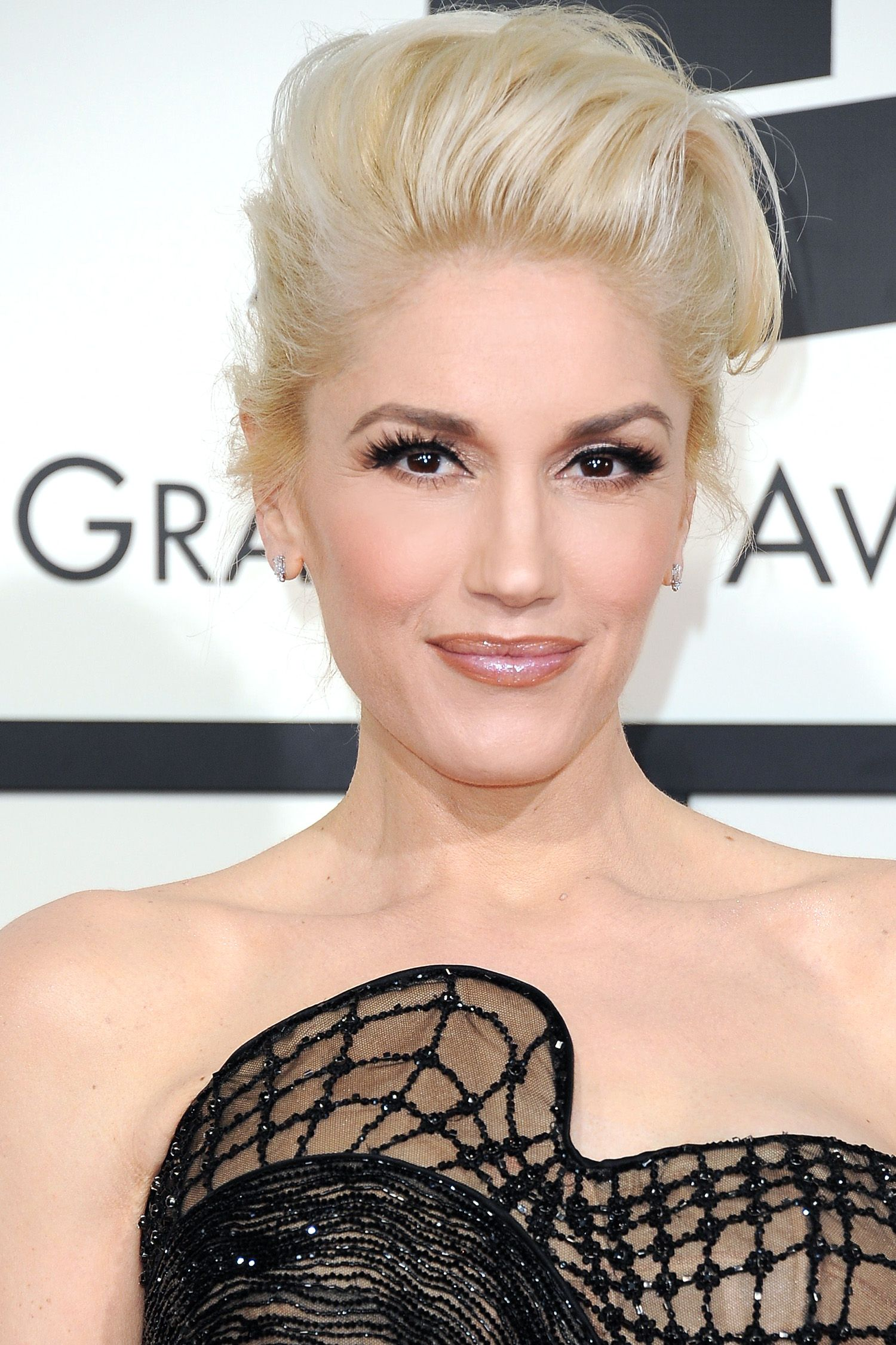 Gwen Stefani arrives on the red carpet for the 57th Annual Grammy Awards in Los Angeles February 8, 2015. AFP PHOTO/VALERIE MACON        (Photo credit should read VALERIE MACON/AFP/Getty Images)