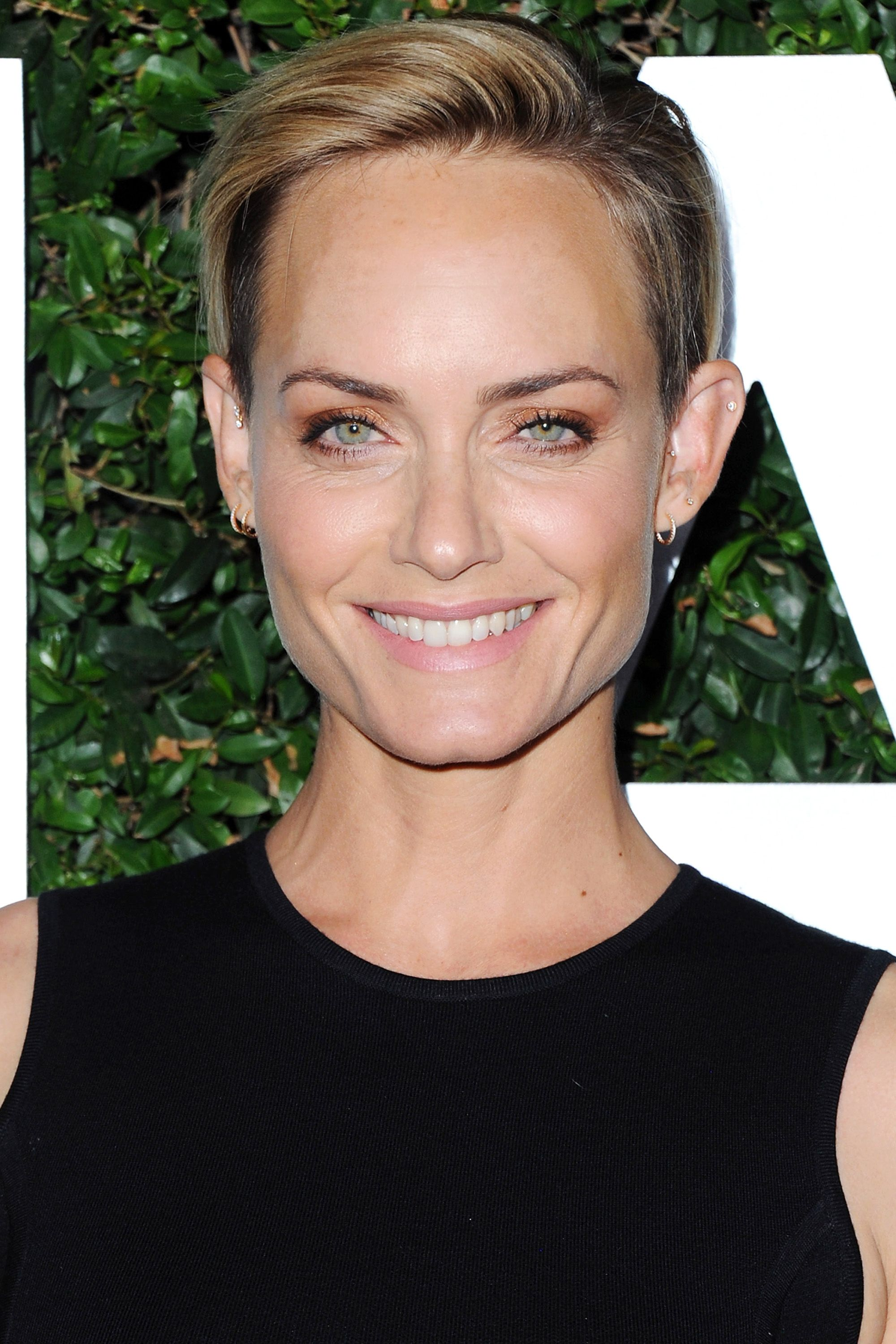 "BEVERLY HILLS, CA - OCTOBER 02:  Actress Amber Valletta arrives at Michael Kors Celebrates The Launch Of Claiborne Swanson Frank's ""Young Hollywood"" Portrait Book on October 2, 2014 in Beverly Hills, California.  (Photo by Jon Kopaloff/FilmMagic)"