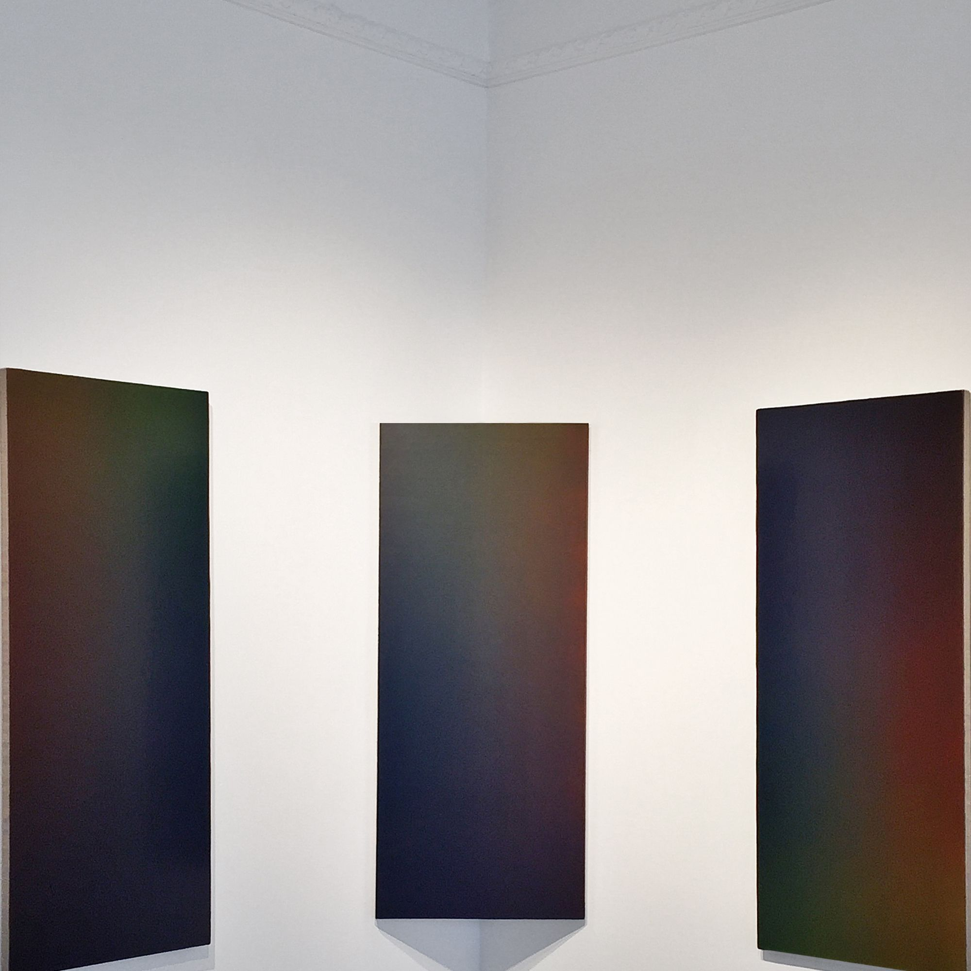 Adam Henry challenges the tradition of painting by reimagining the treatment of its surface.  His emulsion paintings are mesmerizing—displaying bands of color as they move through the spectrum.