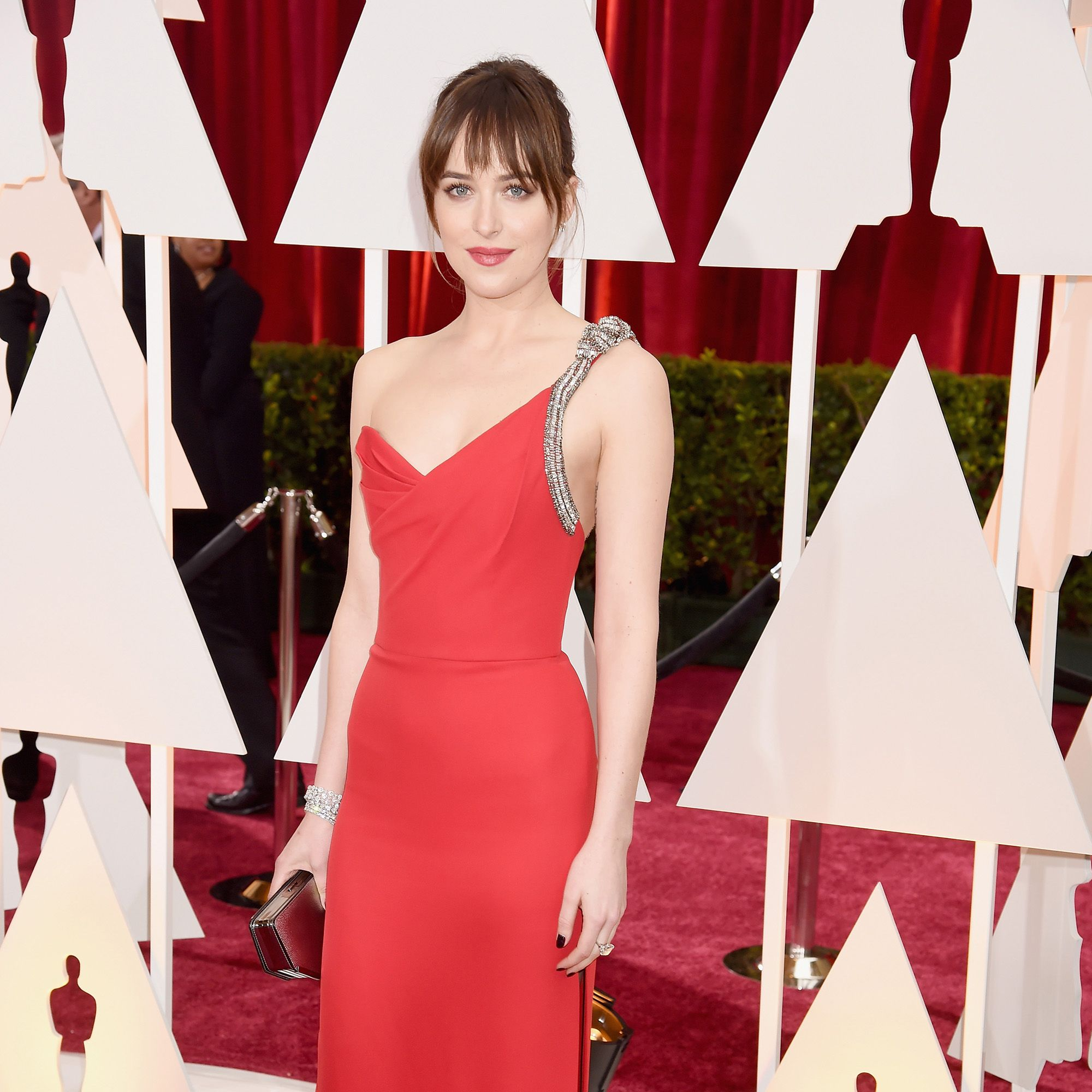 HOLLYWOOD, CA - FEBRUARY 22: Actress Dakota Johnson attends the 87th Annual Academy Awards at Hollywood &amp&#x3B; Highland Center on February 22, 2015 in Hollywood, California.  (Photo by Jeff Kravitz/FilmMagic)