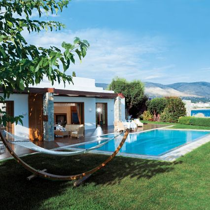"""<a href=""""http://www.lagonissiresort.gr/luxury-accommodation-athens/platinum-club/the-royal-villa.aspx"""">The Hotel&nbsp&#x3B;Grand Resort Lagonissi</a>&nbsp&#x3B;in Athens, Greece offers elite visitors the chance to stay at a beautiful&nbsp&#x3B;villa more akin to a private vacation home. The suite features two master bedrooms, two marble-lined&nbsp&#x3B;bathrooms, a private gym with indoor pool, an outdoor pool, a massage area, fireplace and outdoor terrace. The cost for a&nbsp&#x3B;one night stay at The Royal Villa varies based on visitor's needs, but guests have access to&nbsp&#x3B;a private&nbsp&#x3B;chef, fitness&nbsp&#x3B;trainer and even a&nbsp&#x3B;pianist for the suite, which is located less than an hour from downtown Athens."""