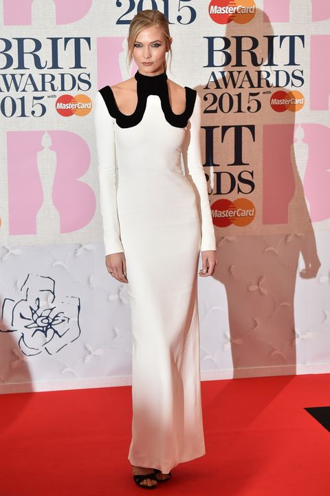 US model Karlie Kloss poses on the red carpet to attend the BRIT Awards 2015 in London on February 25, 2015. AFP PHOTO / LEON NEAL 