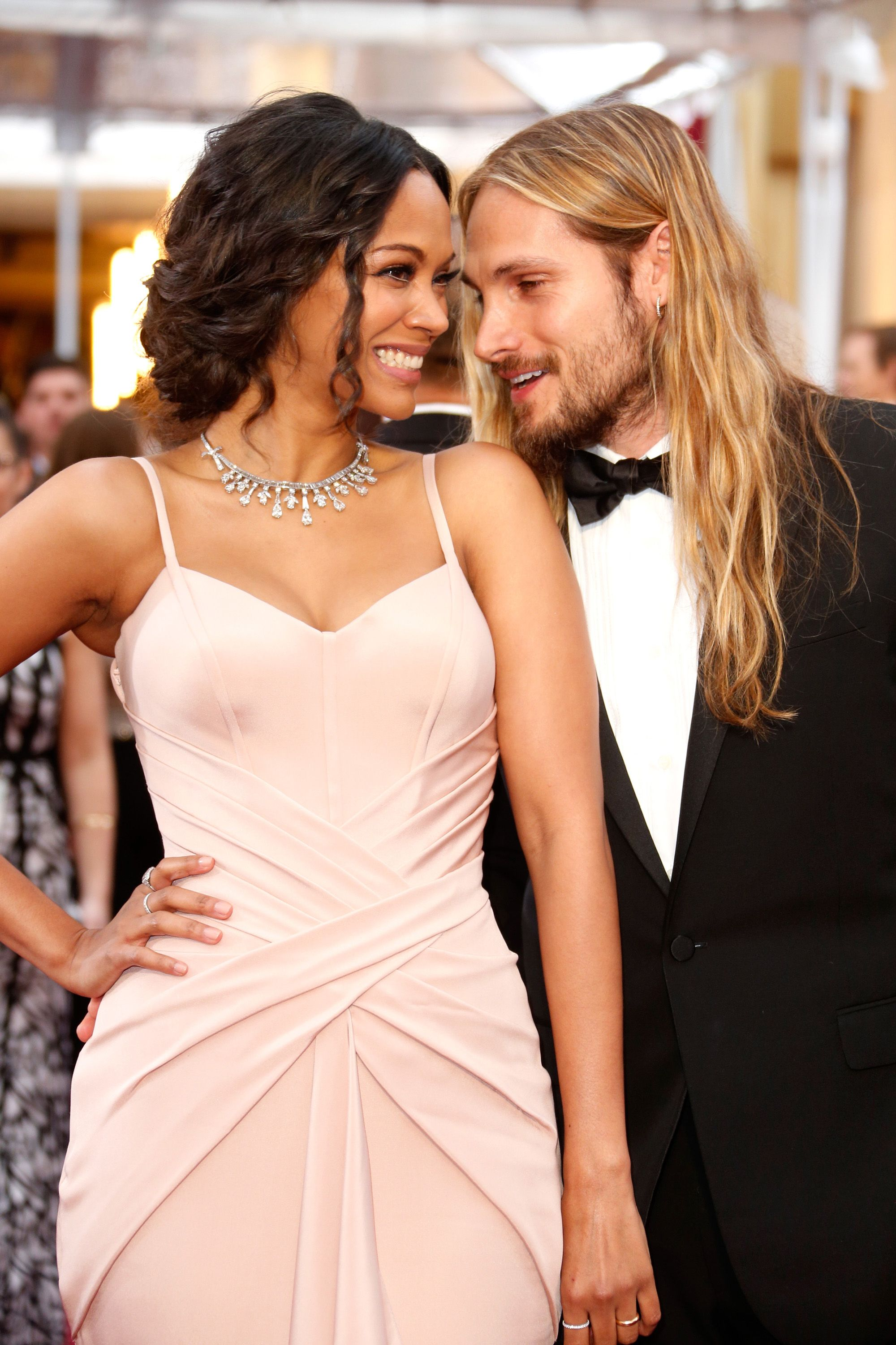 HOLLYWOOD, CA - FEBRUARY 22:  Actress Zoe Saldana and artist Marco Perego attend the 87th Annual Academy Awards at Hollywood & Highland Center on February 22, 2015 in Hollywood, California.  (Photo by Jeff Vespa/WireImage)