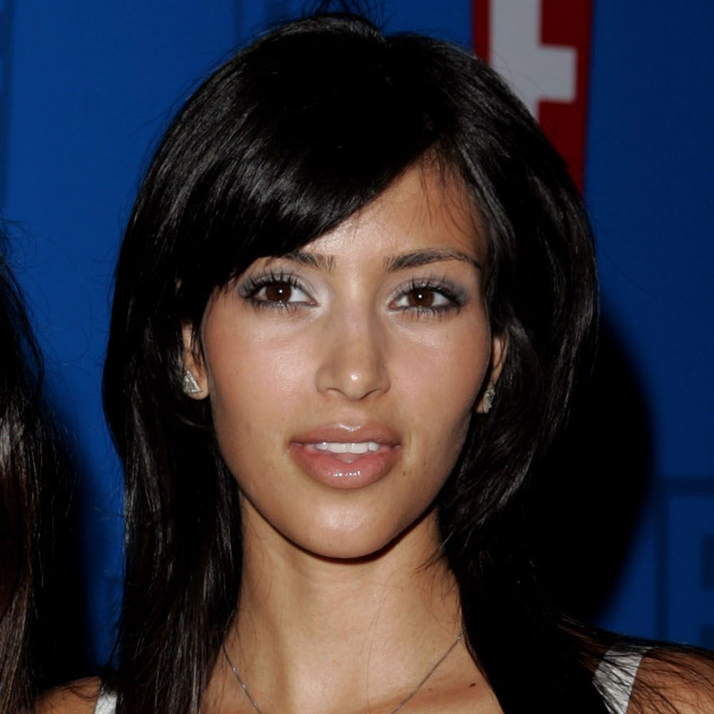 Kourtney Kardashian and Kim Kardashian during E! Entertainment Television's 2005 Summer Splash Event - Red Carpet at Tropicana at The Hollywood Roosevelt Hotel in Hollywood, California, United States. (Photo by J. Vespa/WireImage)