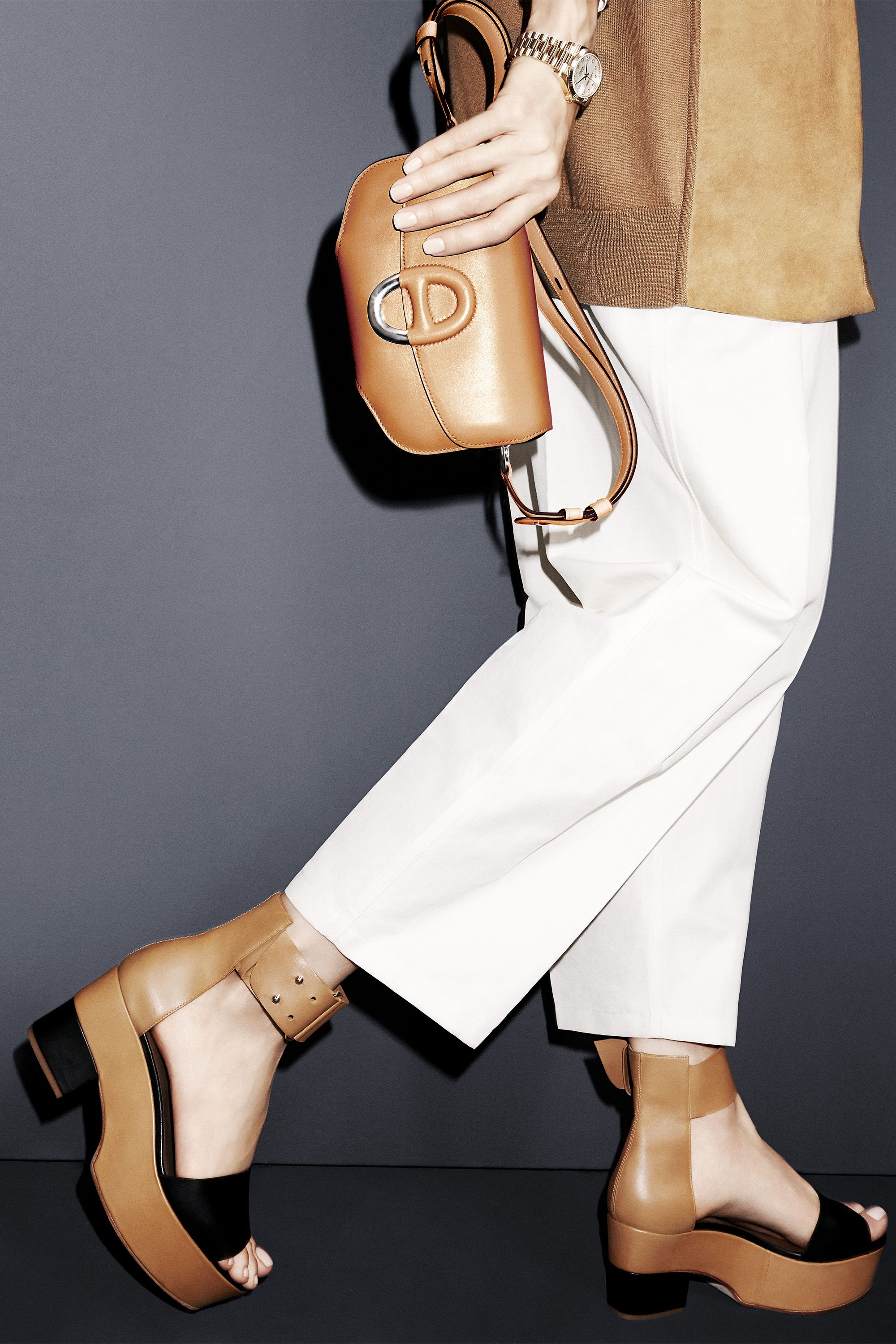 "Get a lift in the season's must-have shoe paired with these generously proportioned trousers that are spring-ready in white.  <strong>Hermès</strong> cardigan, $4,900, pants, $1,475, bag, $8,050 and sandals, $990, 800-441-4488; <strong>Rolex</strong> watch, $31,200, <a href=""http://www.rolex.com"" target=""_blank"">rolex.com</a>."