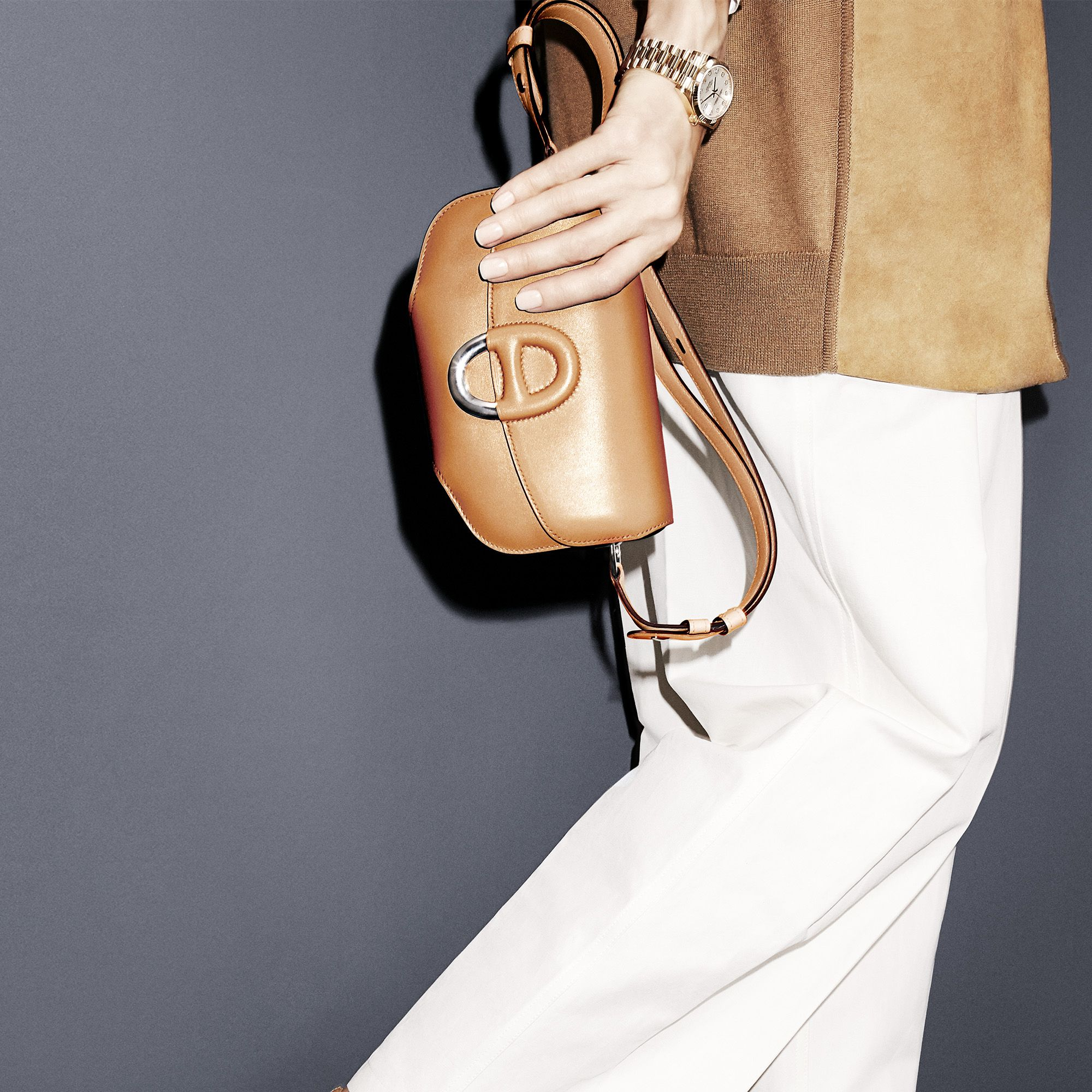"""Get a lift&nbsp&#x3B;in the season's must-have shoe paired with these&nbsp&#x3B;generously proportioned&nbsp&#x3B;trousers that&nbsp&#x3B;are spring-ready in white.<strong>Hermès</strong> cardigan, $4,900,&nbsp&#x3B;pants, $1,475,&nbsp&#x3B;bag, $8,050&nbsp&#x3B;and sandals, $990, 800-441-4488&#x3B;&nbsp&#x3B;<strong>Rolex</strong> watch, $31,200, <a href=""""http://www.rolex.com"""" target=""""_blank"""">rolex.com</a>.&nbsp&#x3B;"""