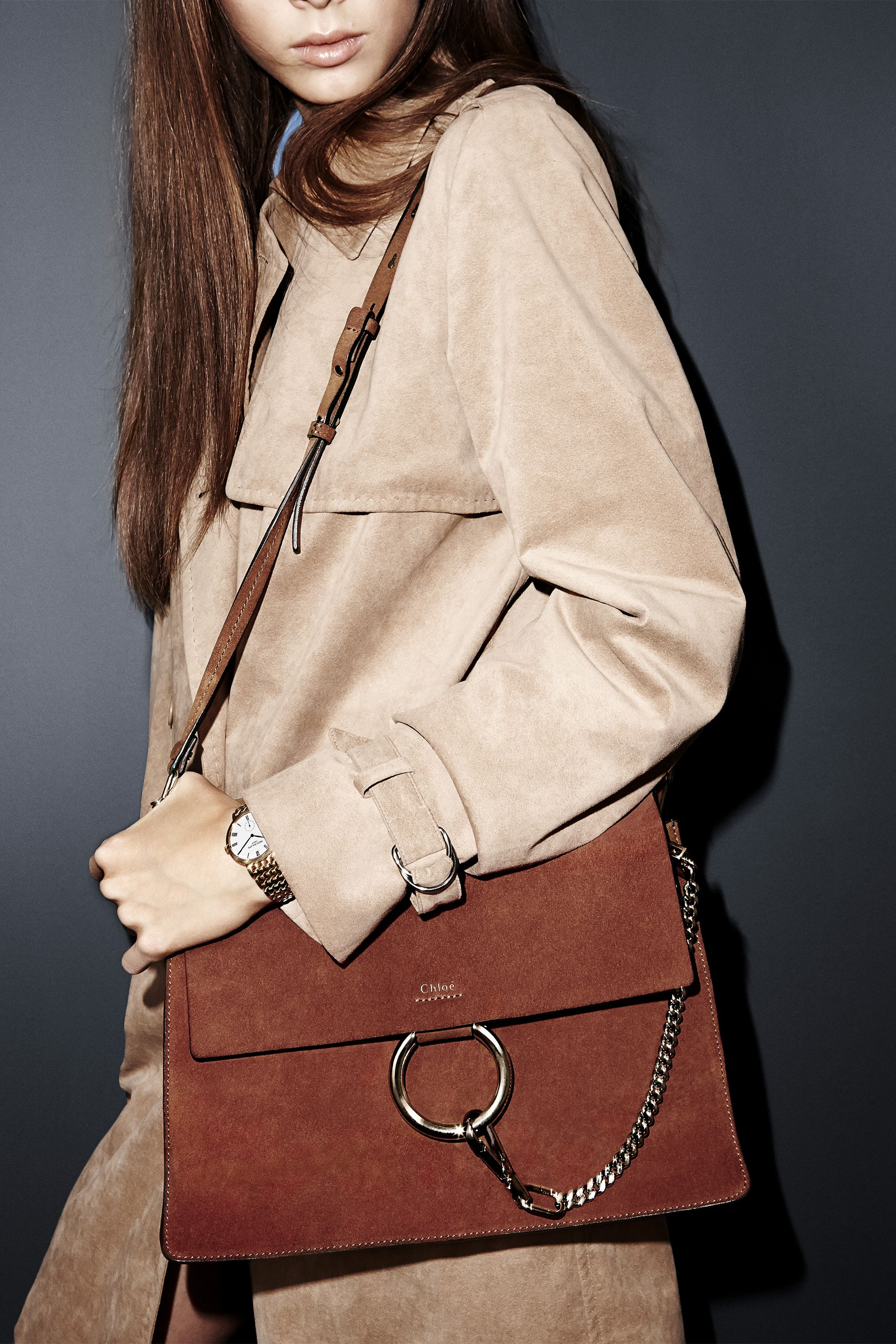 "A coat for all seasons finds a friend in suede while well-placed hardware punches up this structured accessory.  <strong>Max Mara</strong> coat, $1,890, 212-879-6100; <strong>Chloé </strong>bag, $1,920, <a href=""http://shop.harpersbazaar.com/designers/chloe/medium-faye-shoulder-bag/"">shopBAZAAR.com</a>; <strong>Patek Philippe </strong>watch, $38,800, 212-218-1240."