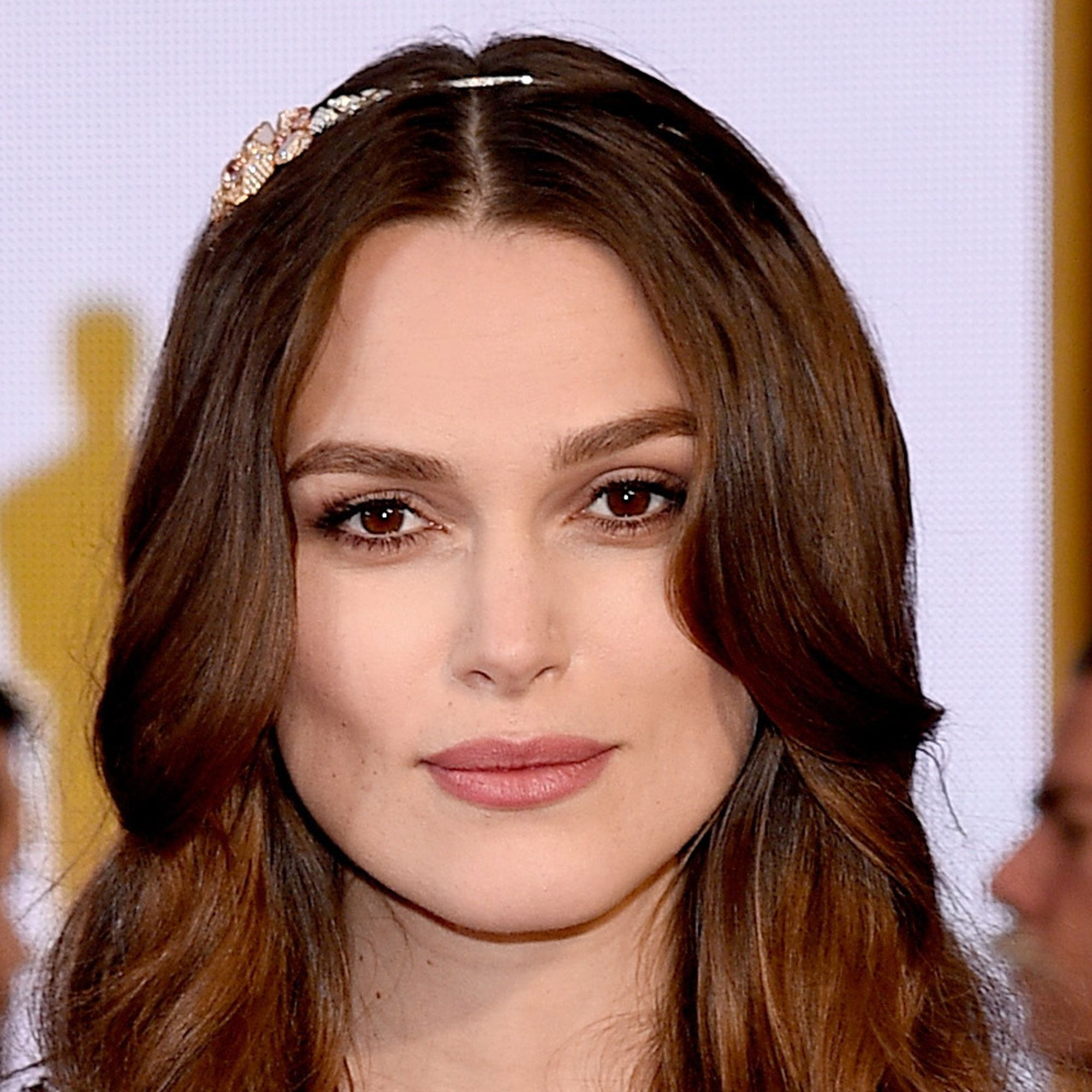 Hairstylist Ben Skervin twisted the actress's hair around the sides of her diamond Chanel headband so that only the jewel stood out on the Oscars red carpet.