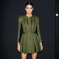 Balmain is known for its classic, French-military inspired bodycon dresses and power shoulders, which Kendall Jenner—a friend of designer Olivier Rousting—shows off to perfection.