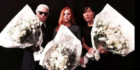 Eyewear, Bouquet, Photograph, Petal, Formal wear, Coat, Suit, Sunglasses, Cut flowers, Fashion,