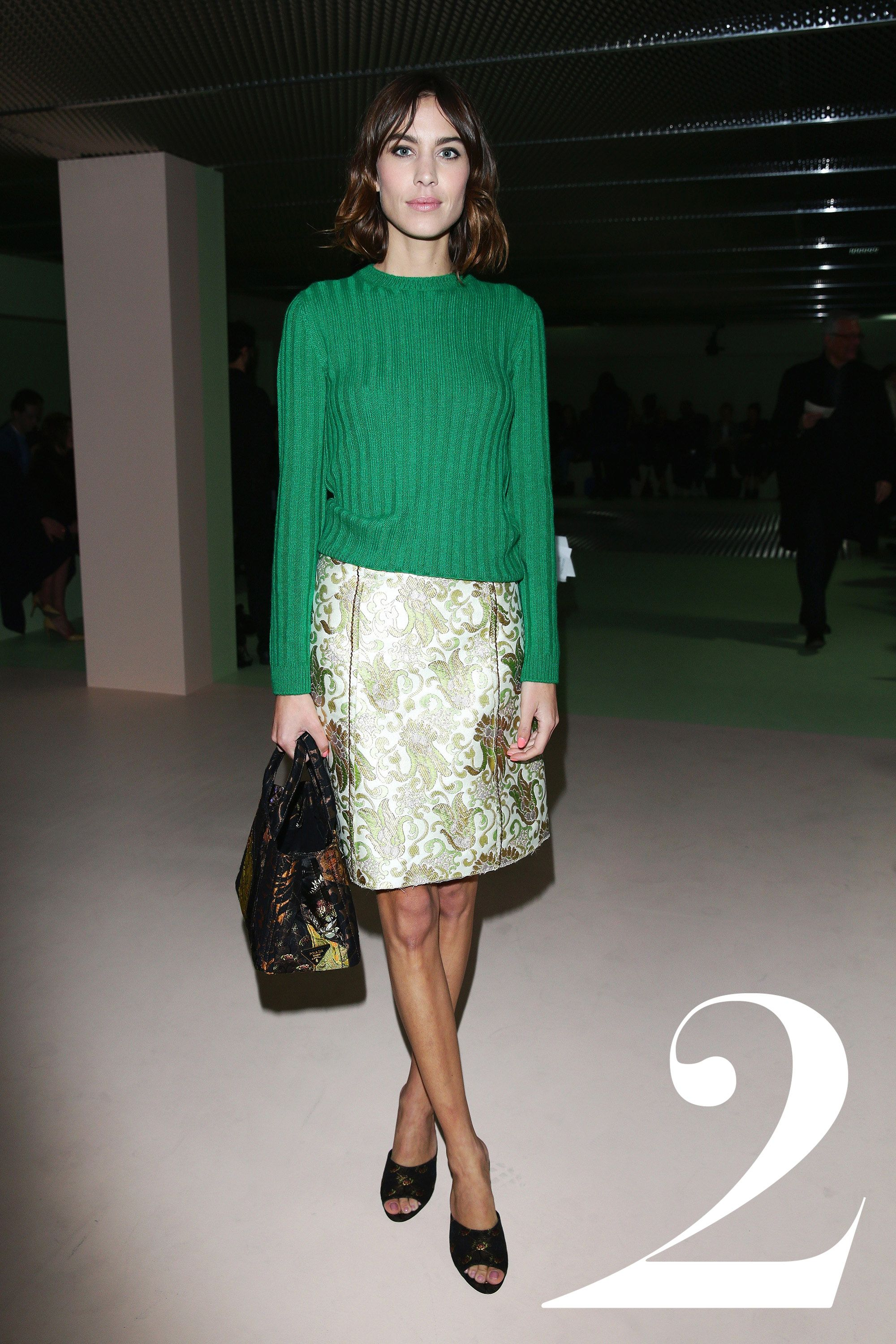 <strong>What: </strong>Prada  <strong>Where:  </strong>Prada Fall 2015 Show  <strong>Why: </strong>Our favorite It Girl radiates a preppy elegance in a golf-course-green ribbed crew neck paired with a shimmering brocade skirt.