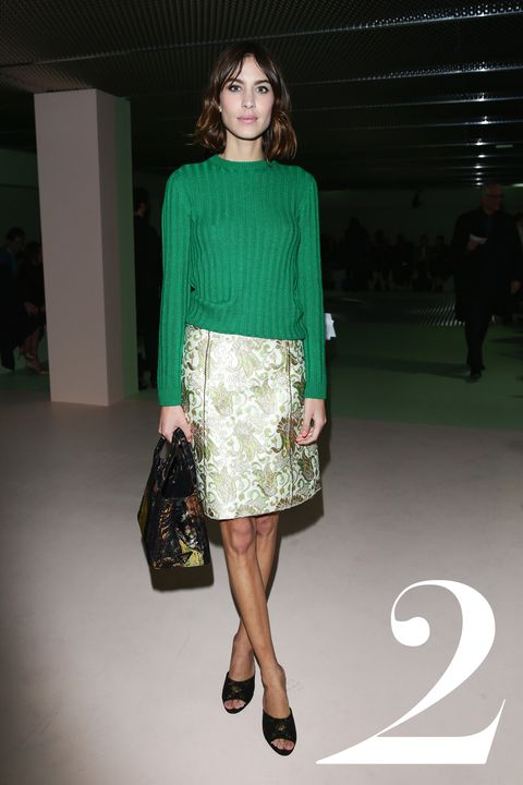 <strong>What: </strong>Prada  <strong>Where: &nbsp;</strong>Prada Fall 2015 Show  <strong>Why: </strong>Our favorite It Girl radiates a preppy elegance in a golf-course-green ribbed crew neck paired with a&nbsp;shimmering brocade&nbsp;skirt.