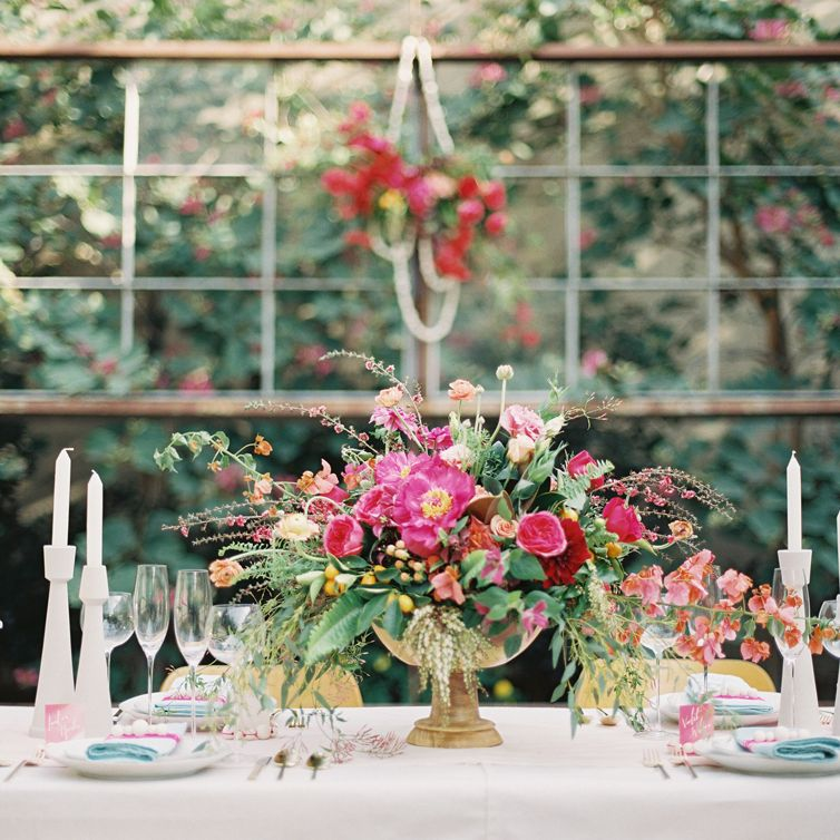 """Use this classic color combo for your spring wedding: Red, pink, and gold create a vibrant visual spread, and paired with the all-white candlesticks seen in <a href=""""http://michaelradfordphotography.com/blog/spring-wedding-inspiration-at-the-elysian-la"""" target=""""_blank"""">this shoot</a>, they're a stark reminder of the beauty of new life."""
