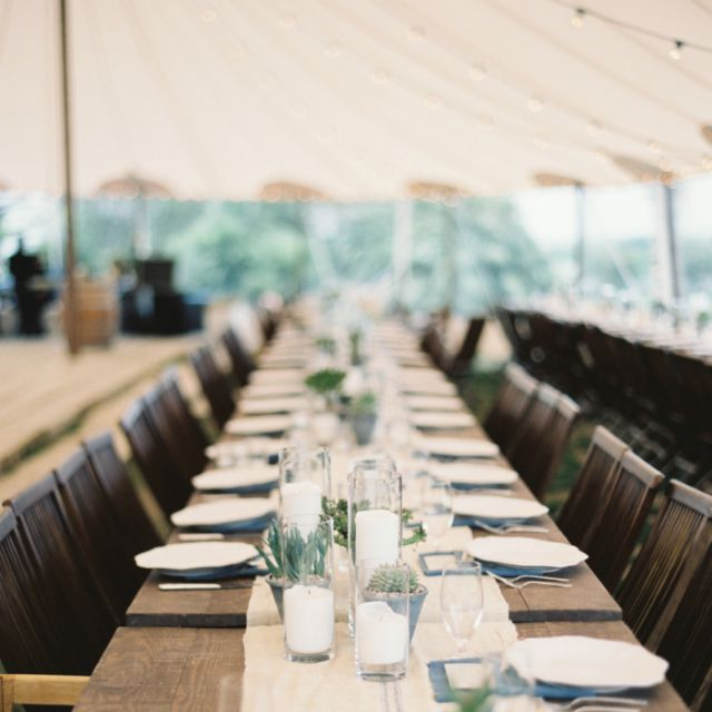 """Of course, a lack of color can be very spring-like too, like in this <a href=""""http://bellesandbubbles.com/springtime-garden-wedding-in-austin/"""" target=""""_blank"""">Austin garden wedding</a>, which paired wooden tables and burlap tableclothes with small succulents to create a simple, conversational atmosphere."""