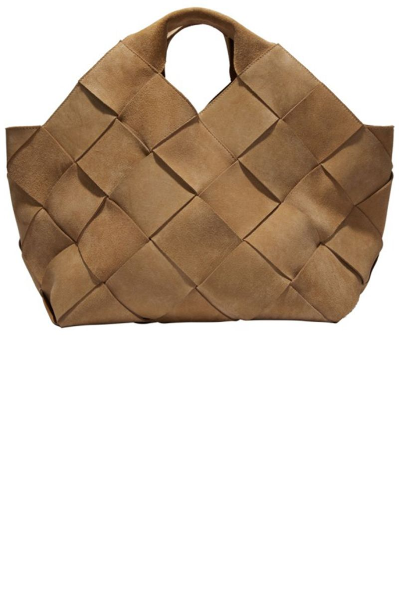 """""""JW Anderson's creative direction at the heritage Spanish brand has brought life back into the house especially in accessories–this market tote is the standout piece and has already been flying off the shelves.""""  <strong>Loewe</strong> bag, $3,390, available March 31, <a target=""""_blank"""" href=""""http://shop.harpersbazaar.com/designers/loewe/small-suede-woven-basket/"""">shopBAZAAR.com</a><img src=""""http://assets.hdmtools.com/images/HBZ/Shop.svg"""" class=""""icon shop"""">."""