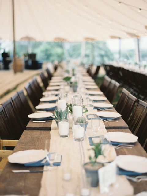 "Of course, a lack of color can be very spring-like too, like in this <a href=""http://bellesandbubbles.com/springtime-garden-wedding-in-austin/"" target=""_blank"">Austin garden wedding</a>, which paired wooden tables and burlap tableclothes with small succulents to create a simple, conversational atmosphere."