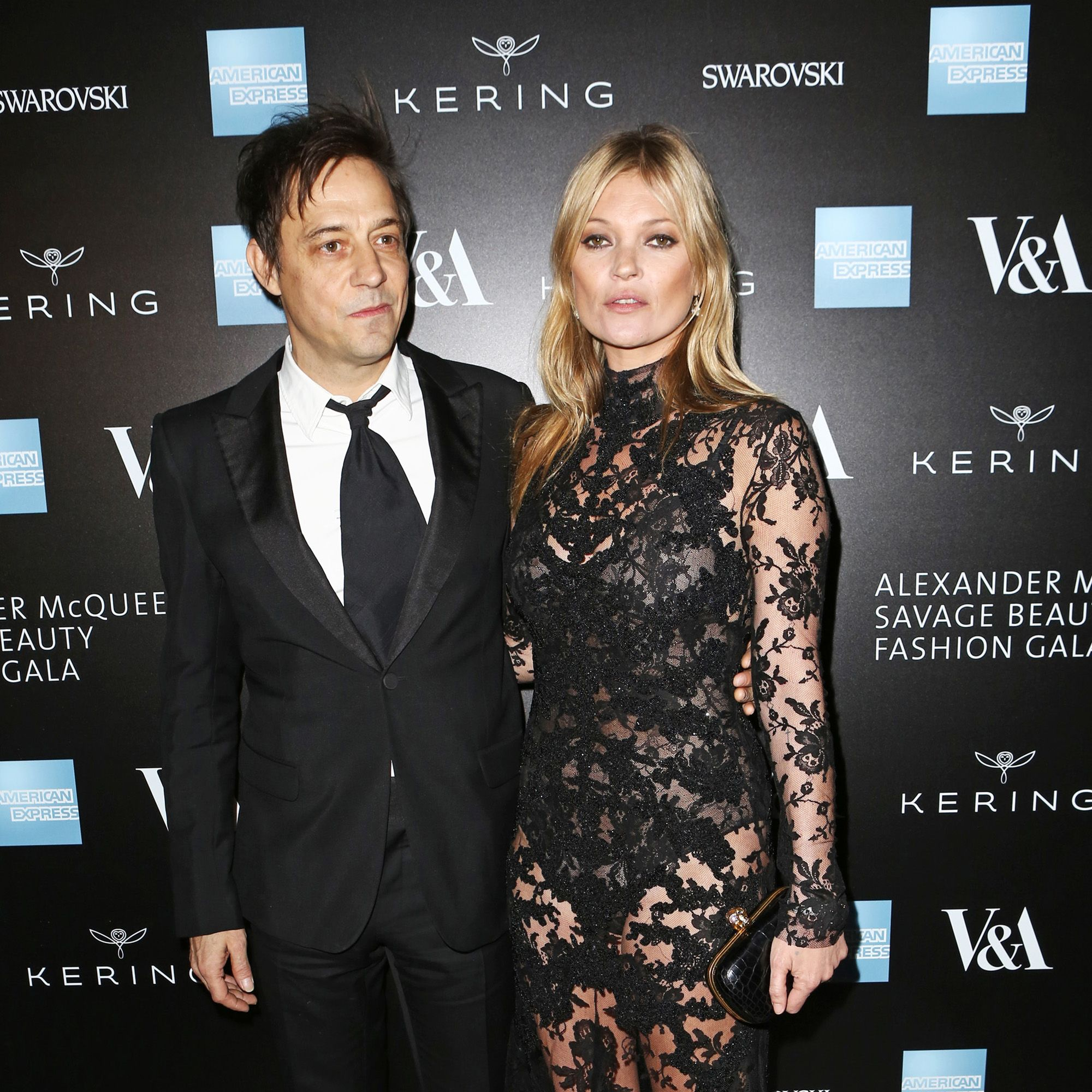 LONDON, ENGLAND - MARCH 12:  Jamie Hince (L) and Kate Moss arrive at the Alexander McQueen: Savage Beauty Fashion Gala at the V&amp&#x3B;A, presented by American Express and Kering on March 12, 2015 in London, England.  (Photo by David M. Benett/Getty Images for Victoria and Albert Museum)