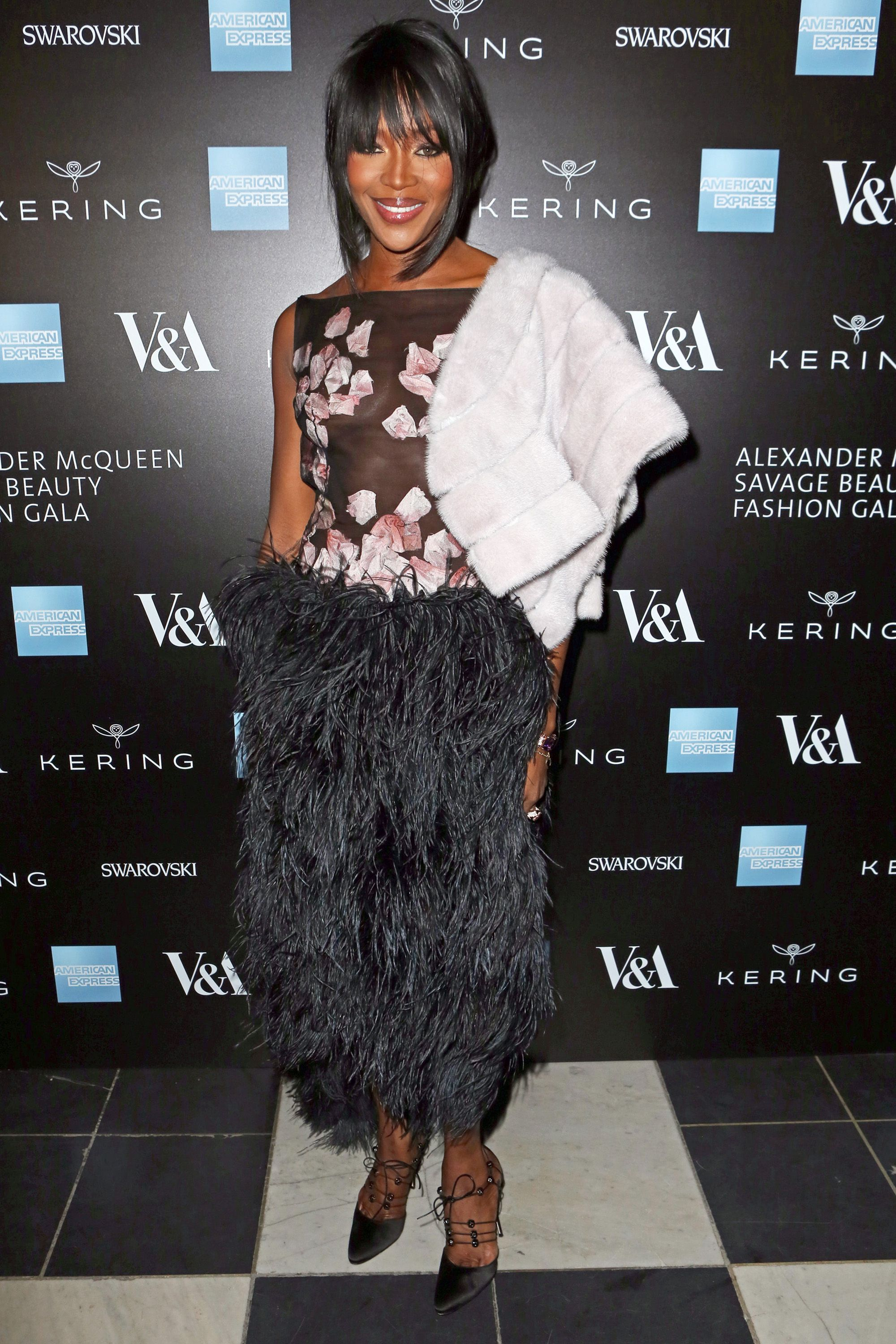 LONDON, ENGLAND - MARCH 12:  Naomi Campbell arrives at the Alexander McQueen: Savage Beauty Fashion Gala at the V&A, presented by American Express and Kering on March 12, 2015 in London, England.  (Photo by David M. Benett/Getty Images for Victoria and Albert Museum)