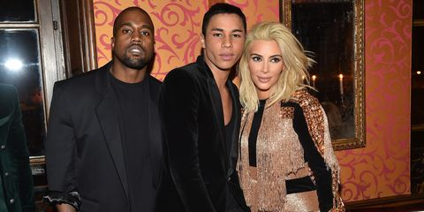 PARIS, FRANCE - MARCH 05:  Kanye West, Olivier Rousteing and Kim Kardashian attend the Balmain Aftershow Dinner as part of the Paris Fashion Week Womenswear Fall/Winter 2015/2016  on March 5, 2015 in Paris, France.  (Photo by Jacopo Raule/Getty Images For Balmain)