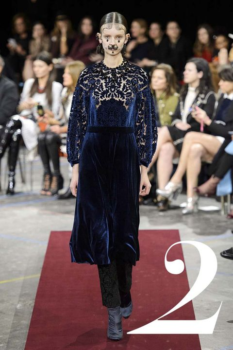 """Riccardo Tisci's """"Chola Victorian"""" navy velvet Devoré dress over trousers is a modern take on this period's consistent influence of the season."""