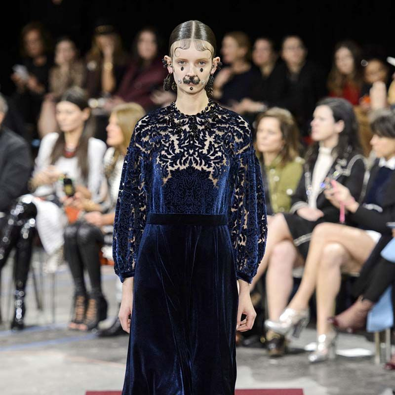 "Riccardo Tisci's ""Chola Victorian"" navy velvet Devoré dress over trousers is a modern take on this period's consistent influence of the season."