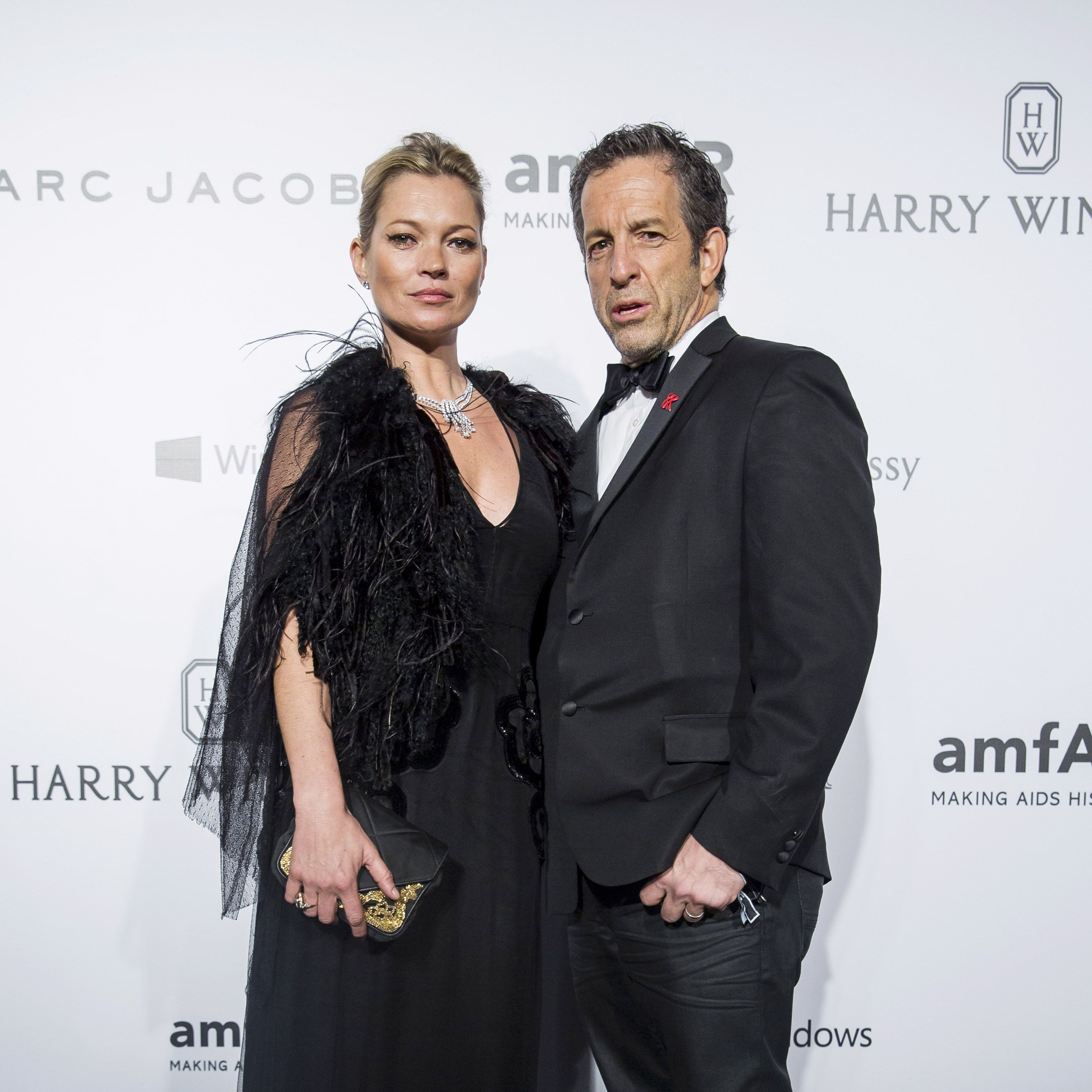 HONG KONG - MARCH 14:  Model Kate Moss (L) and Designer of amfAR and Chairman of the Board Kenneth Cole arrive on the red carpet during the 2015 amfAR Hong Kong gala at Shaw Studios on March 14, 2015 in Hong Kong.  (Photo by Jerome Favre/Getty Images)