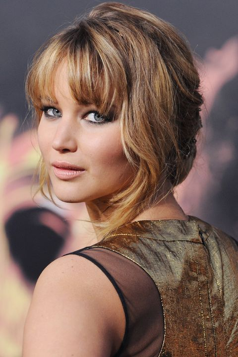 """LOS ÁNGELES, CA - 12 DE MARZO: La actriz Jennifer Lawrence llega en el estreno de Los Ángeles """"los juegos del hambre"""" en el teatro LA del teatro de Nokia el 12 de marzo de 2012 en Los Ángeles, California. (Foto por Jon Kopaloff / FilmMagic)"""