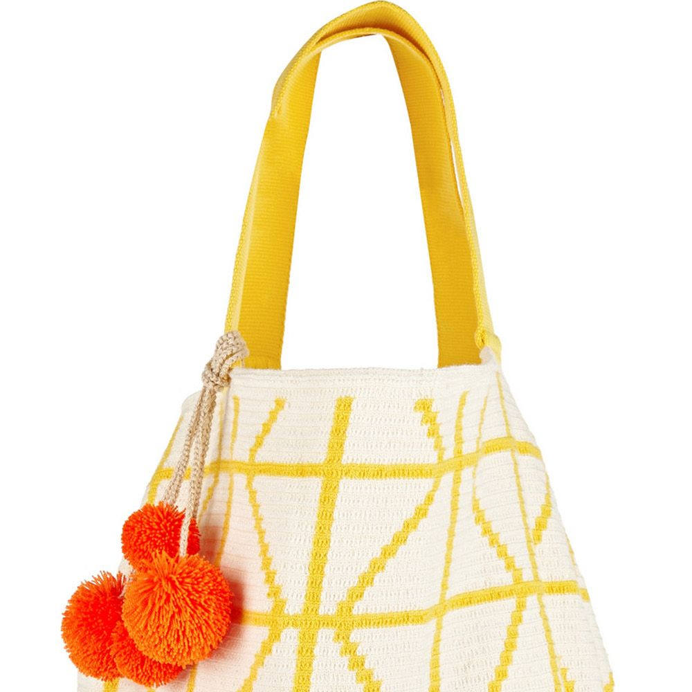 A woven cotton tote is perfect to hold your beach-day essentials and looks just as chic away from the shore. 