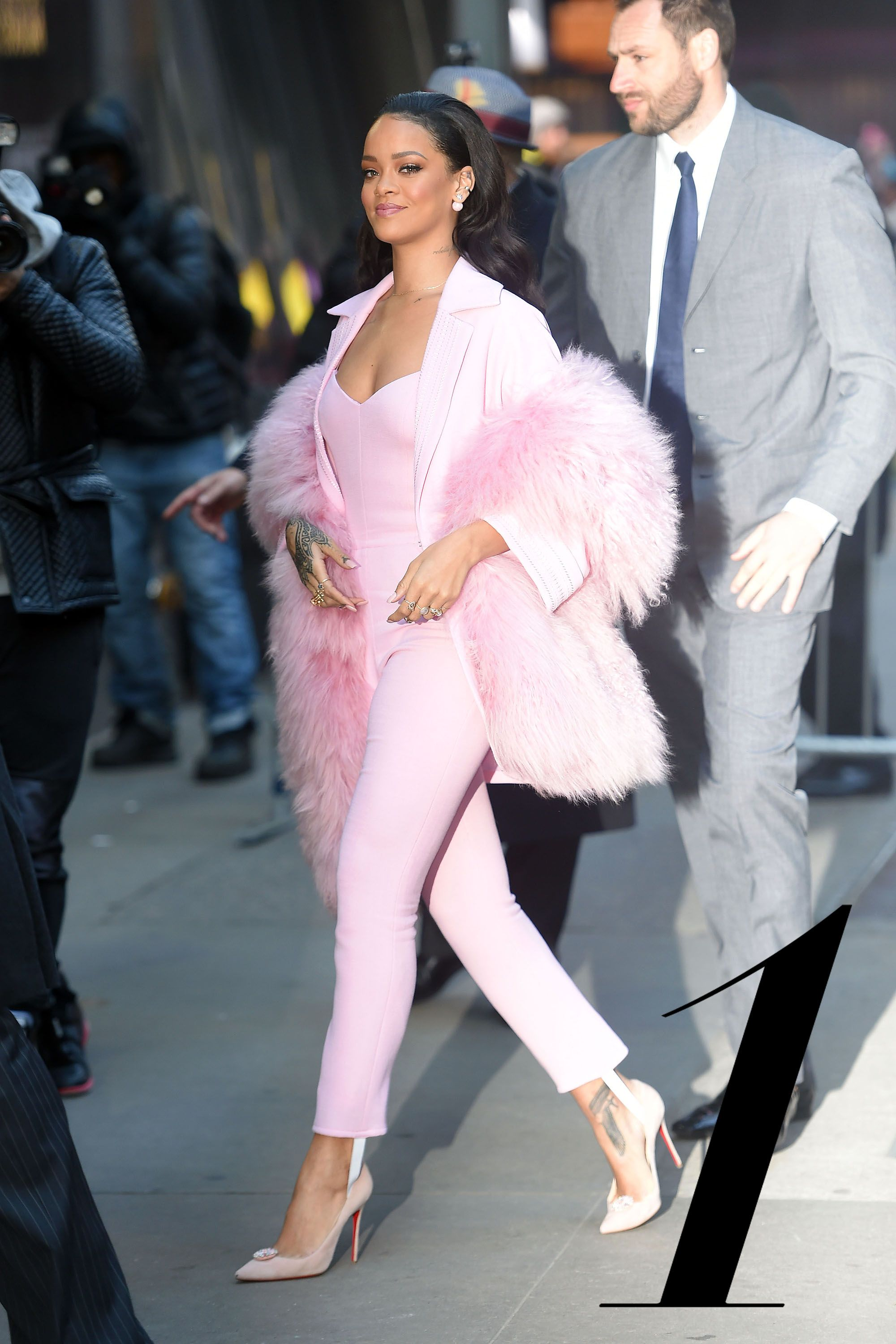NEW YORK - MARCH 13: Rihanna arrives at Good  Morning America in pink on MARCH 13, 2015 in New York, New York.  (Photo by Josiah Kamau/BuzzFoto via Getty Images)
