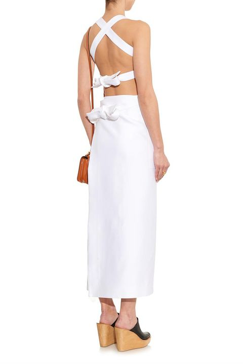 This dress feels understated from the front, but the crossing straps and double bows give it a truly directional feel.