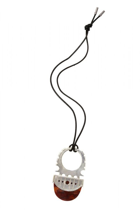 "<strong>Edun</strong> necklace, $1,095, <a target=""_blank"" href=""http://shop.harpersbazaar.com/designers/edun/burnt-orange-pendant-necklace/"">shopBAZAAR.com</a>."